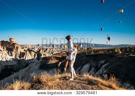 A Couple In Love In Cappadocia. The Couple Travels The World. Vacation In Turkey. Honeymoon In Cappa