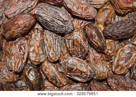 Dates Background. Fresh Arabic Dates. Date Palm Fruit. Top View. Dried Date Fruit Texture.