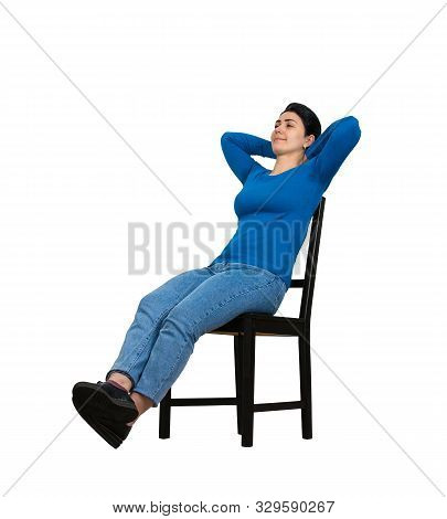 Cheerful Young Woman Relaxing In Her Chair And Enjoying The Free Time Isolated Over White Background