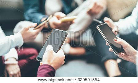 Friends Group Having Addicted Fun Using Mobile Smart Phone - Close Up Of People Hands Sharing Conten
