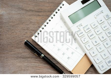Keypad Tax Button For Tax Calculation. Easy To Calculate. On White Calculator Wood Background Using