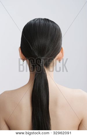 Rear view of Asian woman with ponytail