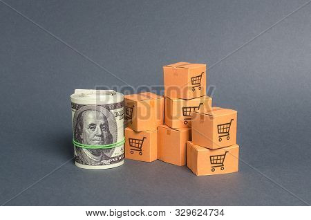 Roll Bundle Of Dollars And Cardboard Boxes. International Trade And Trading Balance. Global Market A