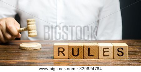 A Man Knocks A Hammer Publishes New Rules And Laws. Setting Clear Rule And Restrictions. Leadership