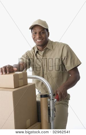 African American delivery man with hand truck