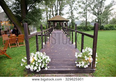 Alcove In Garden And Decorations For Wedding.