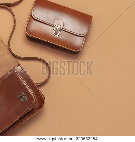 Two Brown Leather Women Bag On Brown Beige Background Top View Flat Lay Copy Space. Fashionable Wome