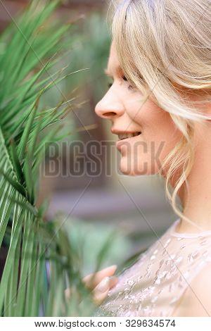 Closeup Portrait Of Caucasian Fiancee And Cedar Wood.