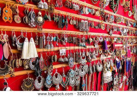 Rishikesh, India - Circa April 2018. Earrings In Souvenir Shop On The Street Of Rishikesh.