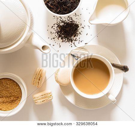 Traditional English Breakfast Black Tea With Milk -tea Leaves. Teacup, Teapot, Sugar And Milk Bowls,