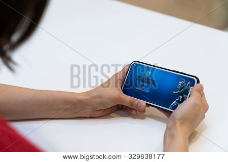 Elva, Estonia - November 15, 2018: Girl Holding Iphone With Online Fortnite Game Epic Games Logo And