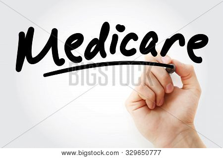 Hand writing Medicare with marker, concept background poster