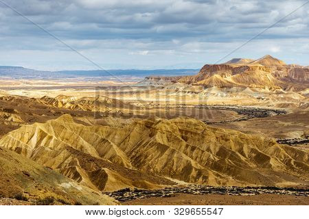 Negev Desert / Israel  -  Feb 19, 2019: Desert Landscape Under A Cloudy Sky, As Seen From Sde Boker
