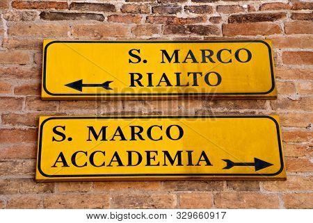 Venice, Italy: Fingerpost To The Attractions San Marco, Rialto Bridge And Accademia Bridge