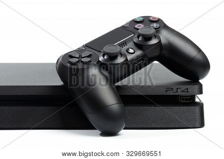 Russia, Oktober 24 2019: Sony Playstation 4 Game Console And Controller, Closeup On A White Backgrou