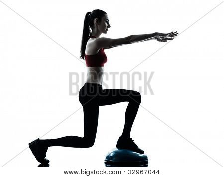 one caucasian woman exercising bosu balance ball trainer in silhouette studio isolated isolated on white background
