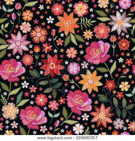Embroidery Seamless Pattern With Bright Flowers On Black Background. Fashion Design For Fabric, Text