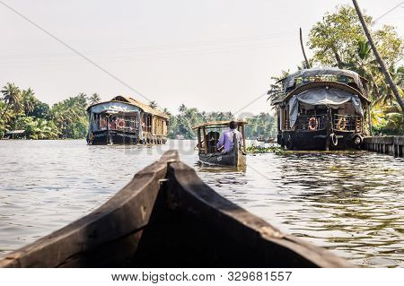 Alleppey - Alappuzha, India - 13 November 2017: Small Boats Going Along House Boats On The River Of