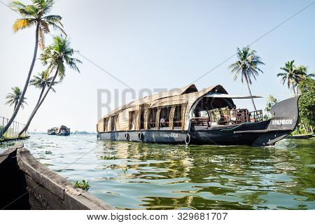 Alleppey - Alappuzha, India - 13 November 2017: Line Of House Boats On The River Of The Kerala Backw