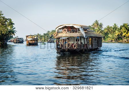 Alleppey - Alappuzha, India - 13 November 2017: House Boats Going Back To The Harbour On The River O