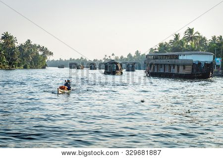 Alleppey - Alappuzha, India - 13 November 2017: Last Sun On House Boats On The River Of The Kerala B