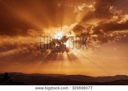 Sky With Clouds And Sun Rays. Sunset Over Mountains. Summer Evening. Dramatic Sky. Beautiful Concept