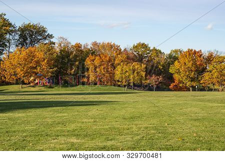 A Playground In The Midst Of Colorful Trees In Autumn