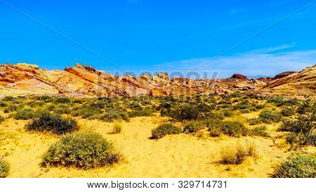 The Colorful Red, Yellow And White Banded Rock Formations Along The Fire Wave Trail In The Valley Of