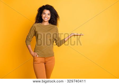Photo Of Pretty Dark Skin Salesperson Lady Holding Novelty Product On Open Palm Proposing Discount P
