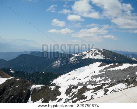 Snow Covered Mountain Peaks On Shika Snow Mountain In Shangri- La, Yunnan, China