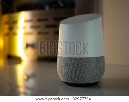 smart home speaker assistant on fireplace with led coloured ambient lighting - Yellow poster