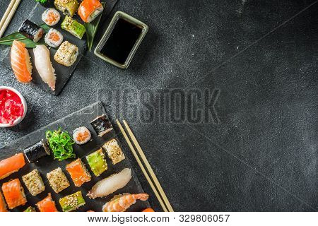 Assorted Sushi Set On Stone Or Concrete Background.  Japanese Classic Sushi, Sushi Nigiri. Rolls, So