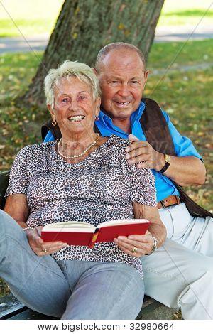 older elderly couple in love. man gives a rose.