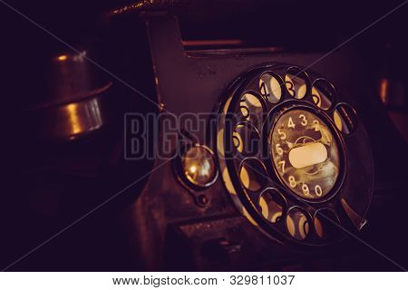 Old, Retro And Vintage Landline Rotary Telephone, Worn-out With Traces Of Usage, Creative And Cinema