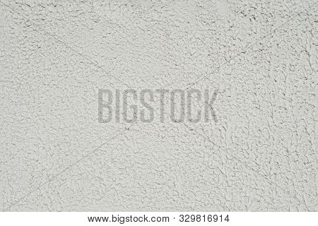 Grey Background Facade Plaster. Exterior Building Structure Backdrop. Silica Sand Cement Wall.