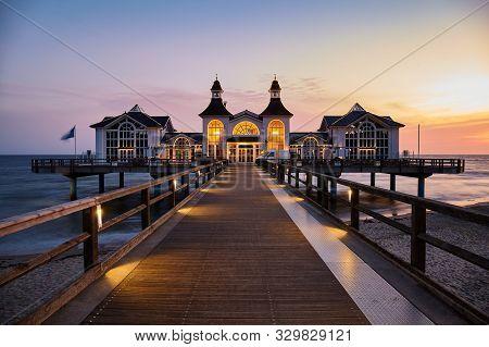 Pier In Sellin At Purple Sunrise, Rugia Island, Germany.