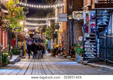 Quebec City, Canada - 4 October 2019: Tourists Visiting Petit Champlain Street In The Old Quebec Cit