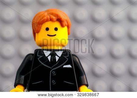 Tambov, Russian Federation - October 19, 2019 Portrait Of Lego Businessman Minifigure Against Lego G