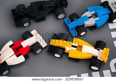 Tambov, Russian Federation - October 21, 2019 Four Lego Race Cars On Road Baseplate. Studio Shot.