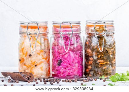 Fermented Preserved Vegetarian Food. Homemade Marinated Cabbage Kimchi, Sea Kale With Carrot, Sauerk