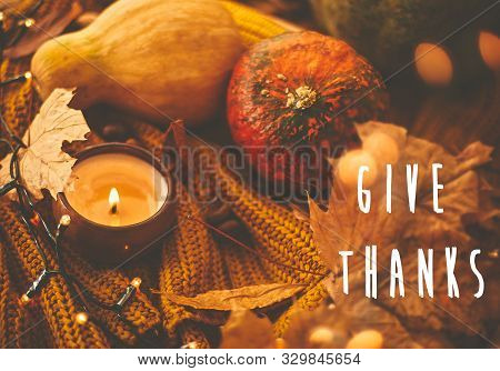 Give Thanks Text Sign, Happy Thanksgiving Greeting Card. Pumpkins, Candle, Golden Lights ,autumn Lea