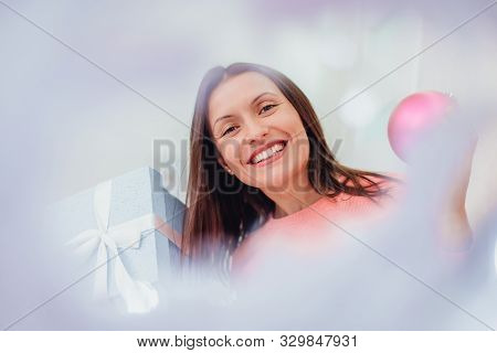 Funny Woman Looking Childish And Playful, Holding Pink Bauble And Present.