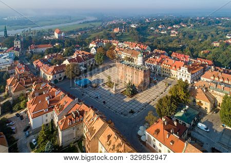Aerial Skyline Panorama Of Sandomierz Old City, Poland, In Sunrise Light. Old Town With Market Squar