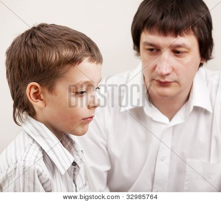 Serious discussion between father and son. Problems in family. Conflict dad and child