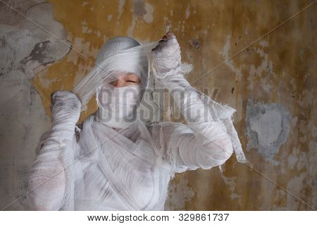 Halloween Image, Mummy In Bandages, Risen Dead Legendary Character. Scary Mummy Tearing His Bandages