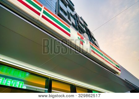 SHENZHEN, CHINA - APRIL 7, 2019: 7-Eleven sign over store entrance in Shenzhen. 7-Eleven Inc. is a Japanese-American international chain of convenience stores.