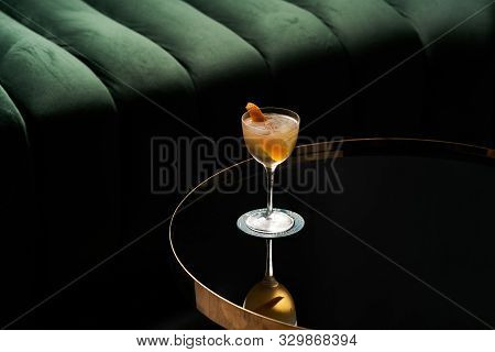 Fresh Cocktail Glass On Glass Table In Night Club Restaurant