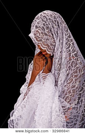 Beautiful black woman in a white veil
