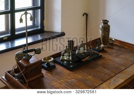 Mir, Belarus -  23-october-2019: Antique Writing Utensils And Retro Telephone On A Wooden Desk At Ex