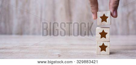 Customer Holding Wooden Blocks With The Three Star Symbol. Customer Reviews, Feedback, Rating, Ranki